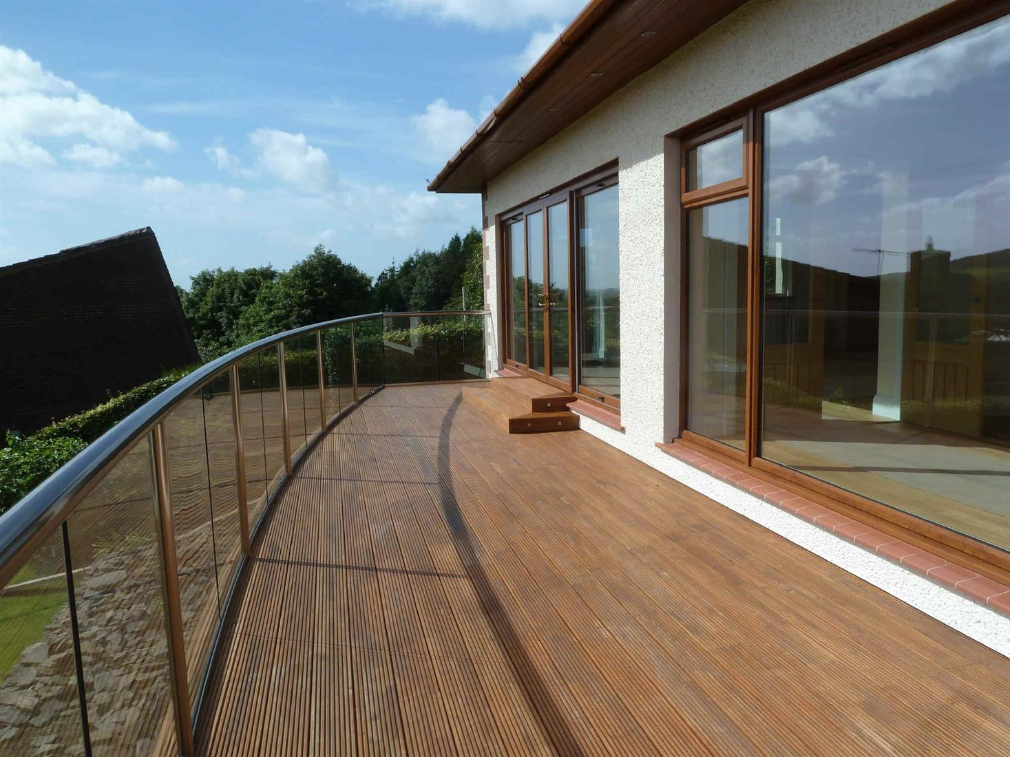 curved glass balustrade with handrail